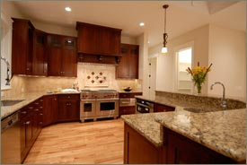 Kitchen Remodel with Brown Cabinets and Granite Countertops 1