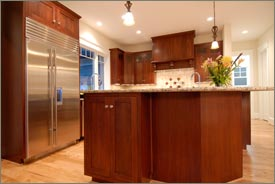 Kitchen Remodel with Brown Cabinets and Granite Countertops 3