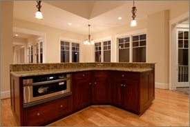 Kitchen Remodel with Brown Cabinets and Granite Countertops 5