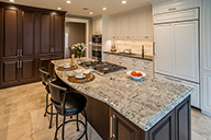 Thumbnail of kitchen with brown cabnietry and granite countertops